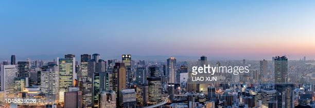 panorama of osaka skyline at sunset - region kinki stock-fotos und bilder