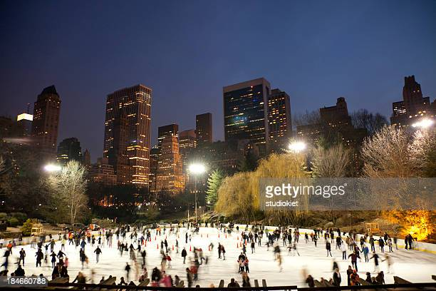 Panorama of people ice skating in Central Park at night