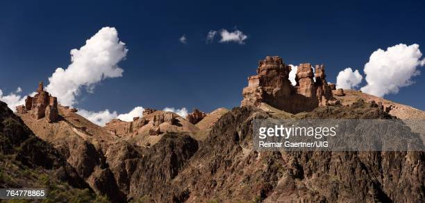 Panorama of red sandstone peaks from the Charyn Canyon river Eco Park Kazakhstan