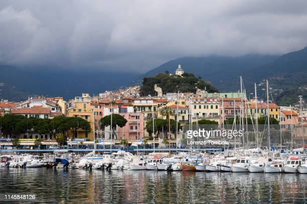 "panorama of san remo -  the harbour and sanctuary of ""madonna della costa"" - san remo italy stock pictures, royalty-free photos & images"