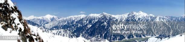 panorama of snowcapped alps - kevin shum foto e immagini stock