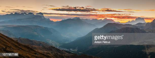 Panorama of sunrise from Pordoi Pass. Dolomites mountains, Italia.