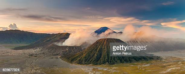 panorama of sunrise over the volcano bromo - mt semeru stock pictures, royalty-free photos & images