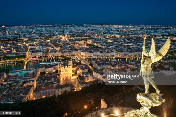 panorama of the city of lyon at night from the roof of the fourviere church - lyon stock pictures, royalty-free photos & images