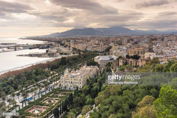 panorama of the city of malaga, spain from the walls and towers of an ancient medieval gibralfaro castle. - istock stock-fotos und bilder