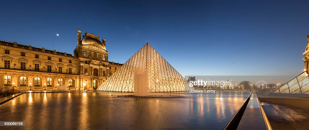 Panorama of the iconic Louvre Museum in Paris at sunset : Stock Photo