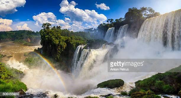 panorama of the iguazu waterfalls with rainbow - イグアス滝 ストックフォトと画像