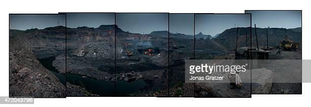 A panorama of the Jharia coal mines Jharia in India's eastern Jharkand state is literally in flames This is due to the open cast coal mining that...