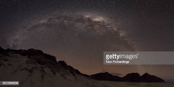 A panorama of the milky way above Wineglass Bay, Freycinet National Park, Tasmania, Australia