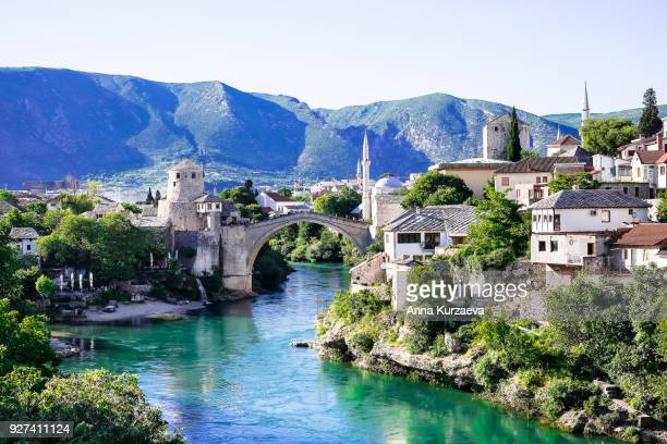 panorama of the old bridge in mostar in a beautiful summer day, bosnia and herzegovina. image with copy space. - former yugoslavia stock pictures, royalty-free photos & images