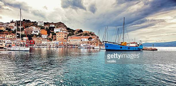 panorama of the port of hydra, greece, under moody sky - hydra greece photos stock pictures, royalty-free photos & images