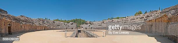 panorama of the roman amphitheatre, italica - amphitheatre stock photos and pictures