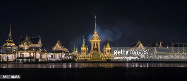 panorama of the royal cremation ceremony at night in bangkok, thailand - crematorium stock photos and pictures
