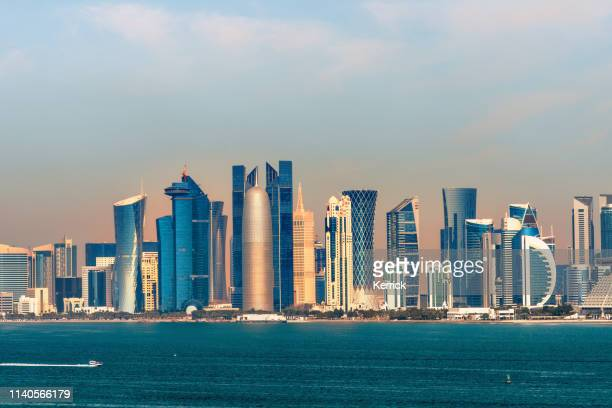 panorama of the skyline doha - capital of qatar in the morning - qatar stock pictures, royalty-free photos & images