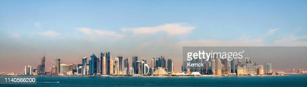panorama of the skyline doha - capital of qatar in the morning - doha stock pictures, royalty-free photos & images