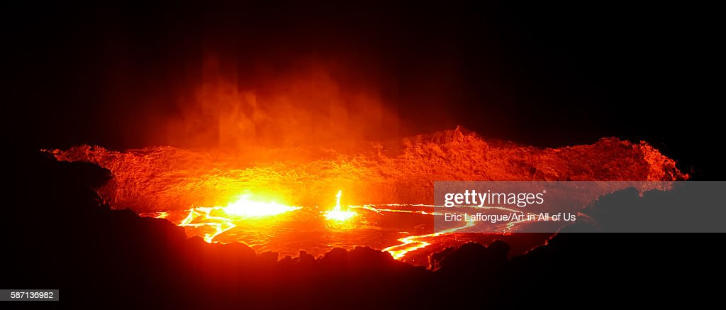 Panorama of the the living lava lake in the crater of erta ale volcano, afar region, erta ale, Ethiopia on February 27, 2016 in Erta Ale, Ethiopia.
