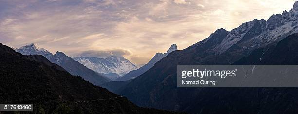 Panorama of the top of Himalayan mountain range with sunrise.