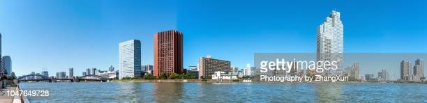 panorama of tokyo cityscape over the sumida river with skyscrapers and buildings and kachidoki bridge, tokyo, japan at day time. - ワイドショット ストックフォトと画像
