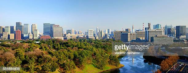 panorama of tokyo's downtown at sunrise - imperial palace tokyo stock photos and pictures