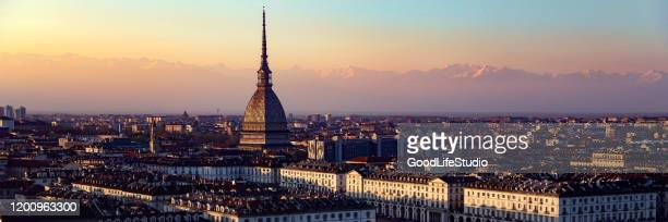 panorama of turin at sunset - torino foto e immagini stock