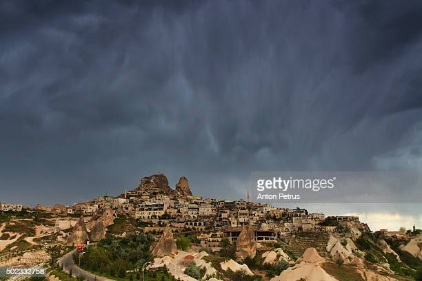 panorama of uchisar under rain cloud. cappadocia, turkey - anton petrus stock pictures, royalty-free photos & images