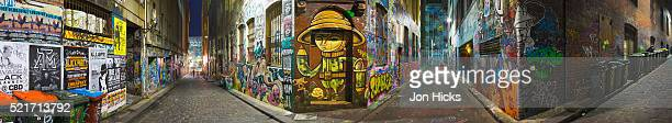 A panorama of walls covered in graffit on Hosier Lane