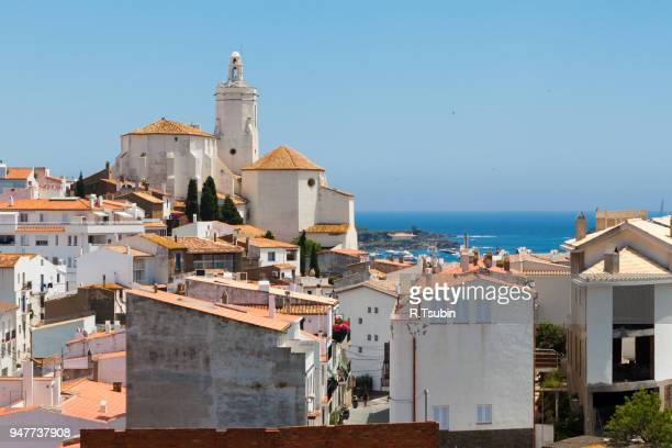 panorama of white village houses and church tower in cadaques, spain - cadaques stock pictures, royalty-free photos & images