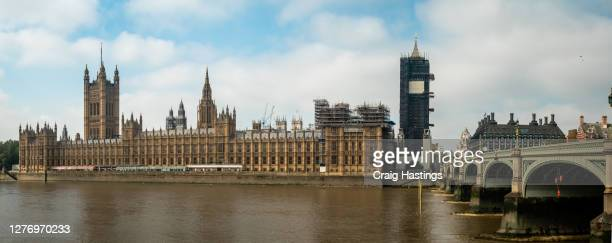 panorama restoration cityscape scene of the house of parliament, elizabeth tower, better known as big ben in london uk - former stock pictures, royalty-free photos & images