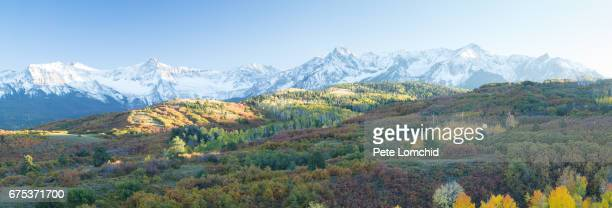 Panorama San Juan Mountains and Aspen trees in fall color at sunrise, Dallas Divide, Ouray