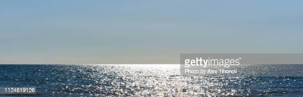 panorama shiny surface of mediterranean sea - ancho fotografías e imágenes de stock