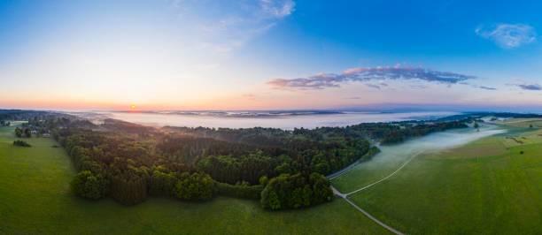 Panorama, sunrise and early morning fog over Isar valley near Icking, Toelzer Land, drone shot, Upper Bavaria, Bavaria, Germany