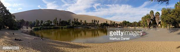 """panorama view of huacachina oasis lake in ica, per - """"markus daniel"""" stock pictures, royalty-free photos & images"""