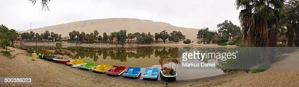 "panorama view of huacachina oasis lake - ""markus daniel"" - fotografias e filmes do acervo"