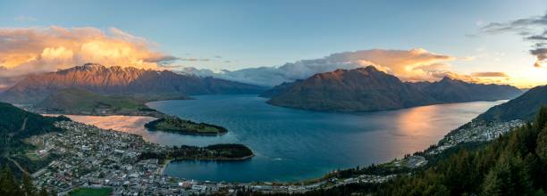 Panorama, view of Lake Wakatipu and Queenstown at sunset, Ben Lomond Scenic Reserve, mountain chain The Remarkables, Otago, Southland, New Zealand