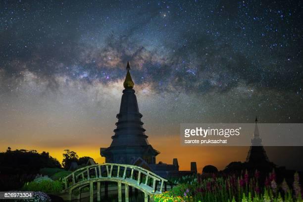 Panorama view Of Landmark pagoda in doi Inthanon national park at Chiang mai, Thailand and milky way .