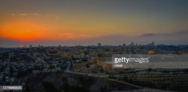 panorama view of sunset over old town jerusalem viewed from mount of olives - jerusalem israel - mount of olives stock pictures, royalty-free photos & images