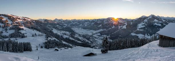 Panorama, view of the Brixen Valley with the first rays of sunshine, sunrise behind a mountain range in winter, Hochbrixen, Brixen im Thale, Tyrol, Austria