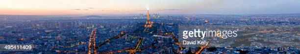 CONTENT] Panorama view of the Eiffel Tower and parisian skyline at twilight