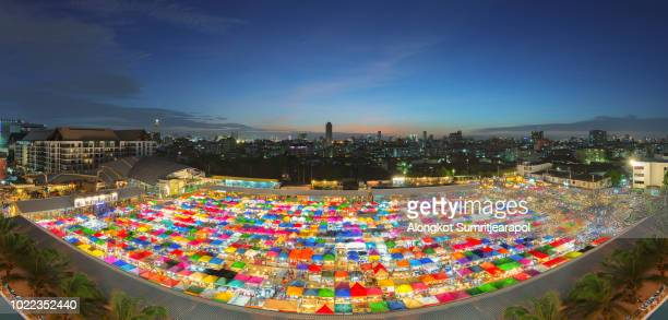 panorama view of the train night market ratchada, also known as talad nud rod fai, bangkok , thailand. - nud stock photos and pictures