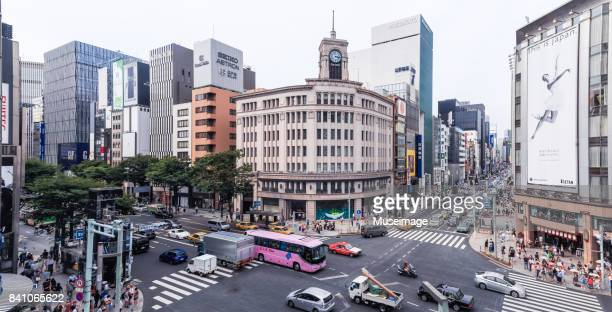 panorama view of the wako building of harumi-dori and chuo-dori streets in ginza, tokyo. - ginza stock pictures, royalty-free photos & images