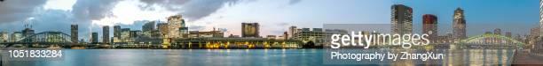 panorama view of tokyo city with kachidoki bridge, tsukiji bridge, tsukiji market, tokyo tower and skyscrapers illuminated, over sumida river, tokyo, japan at night. - kanto region stock photos and pictures
