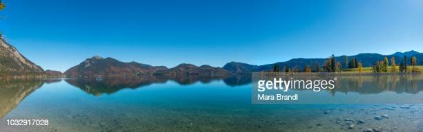 Panorama, view over the lake with Jochberg and the peninsula Zwergern in autumn, water reflection, Walchensee, Upper Bavaria, Bavaria, Germany