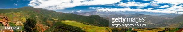 panorama view to atlas mountains and valley morocco - mittlerer teil stock-fotos und bilder