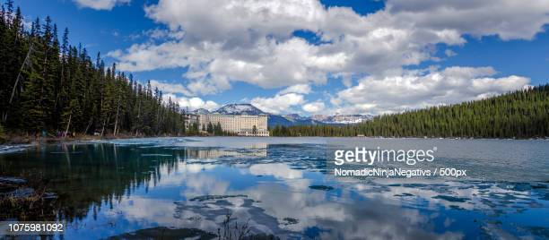 panorama view to fairmont chateau at lake louise - chateau lake louise stock photos and pictures