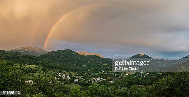 panorama with rainbow after thunderstorm over the valley of castellane, alpes-de-haute-provence, provence-alpes-cote d'azur, france - alpes de haute provence stock photos and pictures