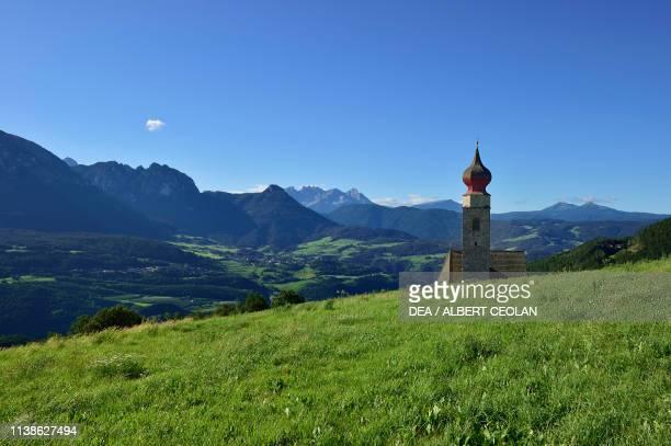 Panorama with St Nicholas Church, Mitterberg, near Lengmoos, Ritten, Trentino-Alto Adige, Italy.
