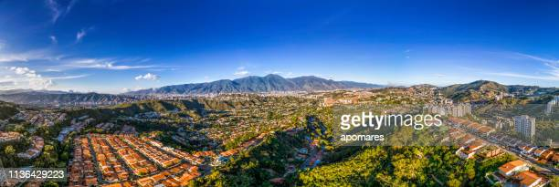 panoramic aerial cityscape of caracas valley with cerro avila at the background. venezuela - caracas stock pictures, royalty-free photos & images