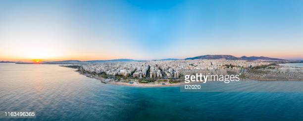 panoramic aerial photo of faliro beach, athens, greece, at summer during sunset - athens greece stock pictures, royalty-free photos & images