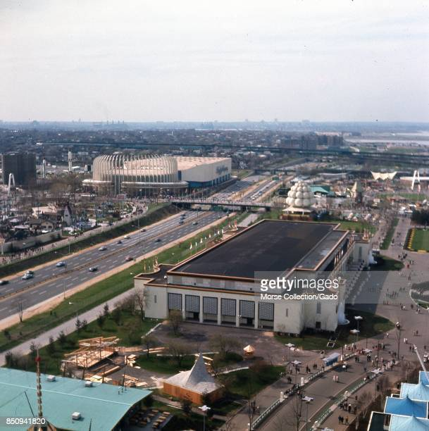 Panoramic aerial view facing northwest across the 1964 New York World's Fairgrounds toward LaGuardia Airport on Flushing Bay in Corona Queens New...