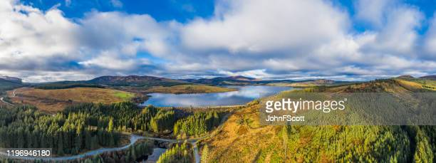 panoramic aerial view of a scottish loch and dam in dumfries and galloway, south west scotland - galloway scotland stock pictures, royalty-free photos & images